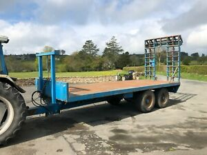 #B1196 23 foot 18T flat plant trailer. Removable hydraulic ramps. 10-stud axles.
