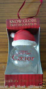 PERSONALIZED CHRISTMAS HANGING SNOW GLOBE, GLITTER GLOBE: RED SANTA HAT - CONOR