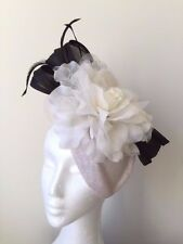 White fascinator with black silk abaca loops, feathers and white flower!