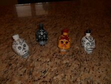 4 empty Kah 50 ML tequila skull bottles