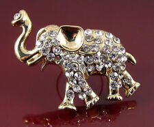 Chunky gold elephant ring set with sparkling faceted pale purple round crystals