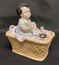 Antique Porcelain Fairing Trinket Box Baby in a Basket with Trumpet & Doll (RJN)