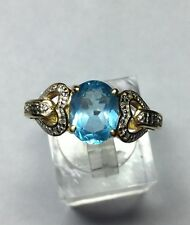 Pretty 14Kt Yellow Gold Blue Topaz And Diamond Ring
