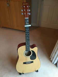Godman Acoustic Guitar with Pickup. Includes Adam Hill guitar stand