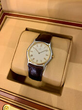Ebel 1911 35mm, Ivory Roman Dial - Yellow Gold & Steel on Strap