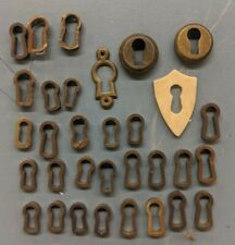 Assortiment of Antique and New Furniture Escutcheons, Keyholes
