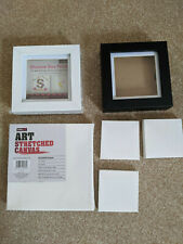Various canvas and shadow boxes