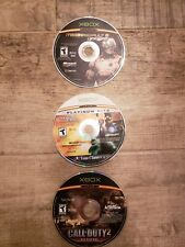 Lot × 3 Xbox games in good condition: Call of duty 2, Splinter Cell, Lone Wolf.