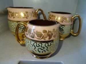 SET OF THREE SADLER MILK JUGS GOLD PINK GREEN