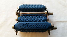 Antique motorcycle pedals available in Black, red, and blue.