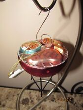 Robert stanley,Glass Christmas ornament, grill with food.