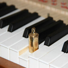 White piano keys measuring heavy weights (copper / 70 g) jack