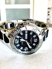 CROTON MENS ORIGINAL SUPER C DAY -DATE STAINLESS STEEL AND SILICONE WATCH...