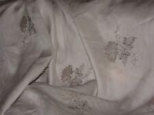 tissu applications brodés coton et  lin naturel en  130 cm de large au mètre