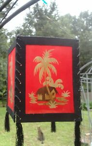 Asian Red Cloth Hanging Lantern with Bamboo Hut and Palm Trees