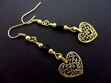A PAIR OF GOLD COLOUR DANGLY HEART  EARRINGS. NEW.