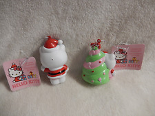 CHRISTMAS SET OF 2 HELLO KITTY/SANTA OUTFIT/STANDING BY TREE BLOW/MOLD ORNS-NEW