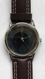 Corum Peacock Feather 18kt 750 Weissgold Gold