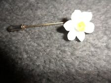 ladies white flower pin with yellow centre