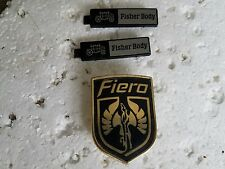 GOLD PONTIAC FIERO HOOD BADGE / BODY BY FISHER DOOR SILL NAME PLATES