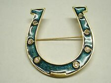 Horse Shoe Brooch With Green Sparkle Design