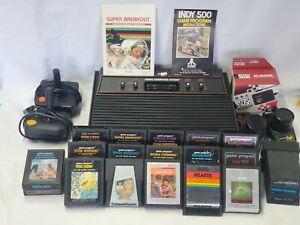 Atari 2600 Console 4 switch Paddles Joysticks 20 games WORKING bundle lot