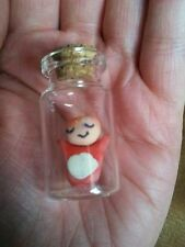 Ponyo from Studio Ghibli in a mini glass bottle with cork.