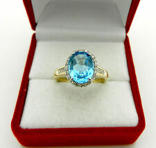 Beautiful 14k Yellow Gold Blue Topaz & Diamond Halo Style Ring size 7.25