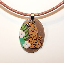 Leopard and flower print acrylic pendant on a tan leather necklace