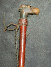 An antique Victorian riding whip, carved animal, horse or dog head handle