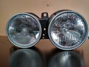 BMW E30 headlight right Euro Hella !!NEW!! OEM 63121373562