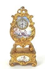 DESKTOP CLOCK IN MINIATURE. ROCOCÓ STYLE. GOLD METAL. VIENNA. XIX CENTURY.