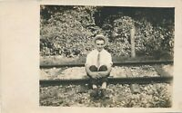 Young Man Sitting on Railroad Tracks Real Photo Postcard rppc