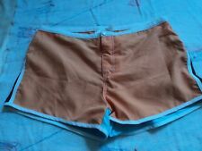 No Boundaries Junior L(11/13) orange, teal shorts.  Polyester