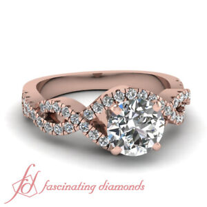 1 Carat Rose Gold Intertwined Style Engagement Ring With Round Diamond In Center