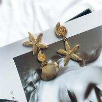 der Sternfische Senken der Schalldämpfer Asymmetrische Ohrringe mit Schalen