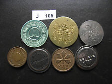LOT OF 7 TOKENS. J105