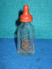 VINTAGE CLEAR GLASS TOY DOLL BABY BOTTLE WITH EMBOSSED DOG SUN BABE NIPPLE