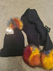Ladies hat and scarf set with multicoloured pom poms