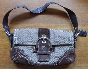 Vtg. pre-owned Coach Soho mini signature Hobo Baguette handbag, model C05J-3628