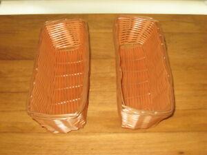 2 PLASTIC WICKER BASKETS