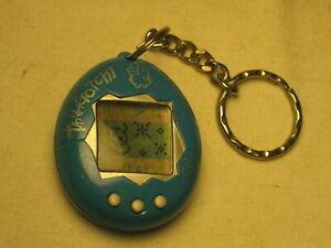 vintage TAMAGOTCHI electronic LCD key chain blue w/ silver writing virtual pet