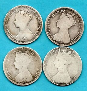 4 VICTORIA GOTHIC FLORIN SILVER COINS 1872 - 1885. IN A USED CONDITION. JOB LOT.