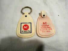 2-1976 AC Spark Plug Employee Family Day Key Chains