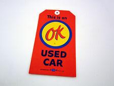 NOS CHEVROLET DEALER OK USED CAR WARRANTY ORANGE TAG WITH HOLE
