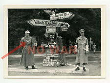 WWII PHOTO German policeman in city after German MILITARY SURRENDER street signs