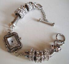 Silver finish moving charm Rhinestones toggle closure dressy fashion women watch