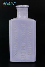 Unique PURPLE MILK glass G. W. LAIRD PERFUMER opaque color ANTIQUE bottle