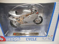 Motos miniatures multicolores en plastique