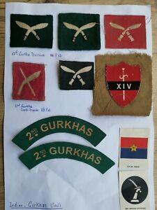 Selection of Gurkha regimental cloth badges and shoulder titles